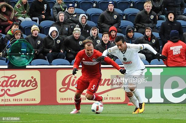 Philadelphia Union midfielder Ilsinho gets past Chicago Fire defender Michael Harrington during a game between the Philadelphia Union and Chicago...
