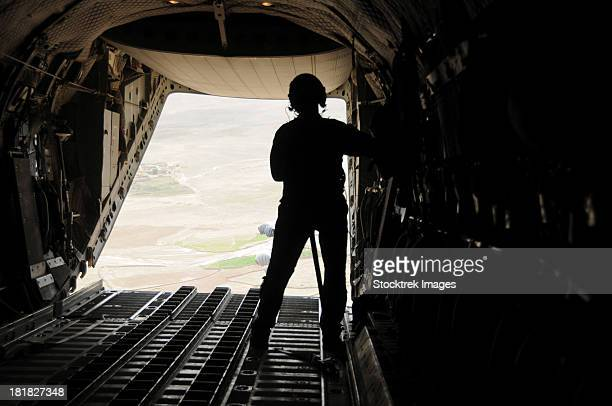 April 22, 2012 - A loadmaster watches more than four tons of supplies airdrop out of the C-27J Spartan near Zabul Province, Afghanistan.