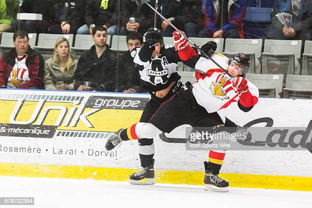 Aaron Hoyles of the BlainvilleBoisbriand Armada checks Valentin Zykov of the BaieComeau Drakkar in game 3 during the third round of the 2014 QMJHL...