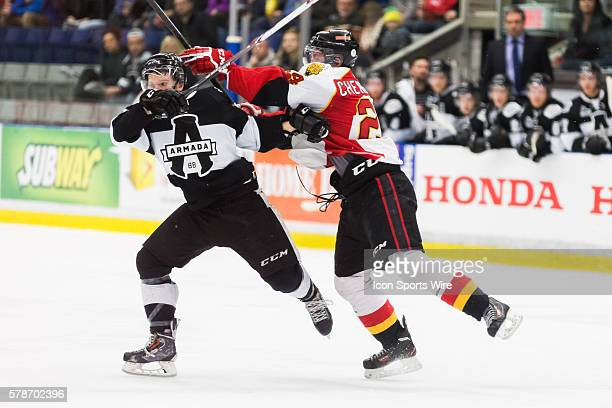 Alexandre Chenevert of the BaieComeau Drakkar checks MarcOlivier Roy of the BlainvilleBoisbriand Armada in game 3 during the third round of the 2014...