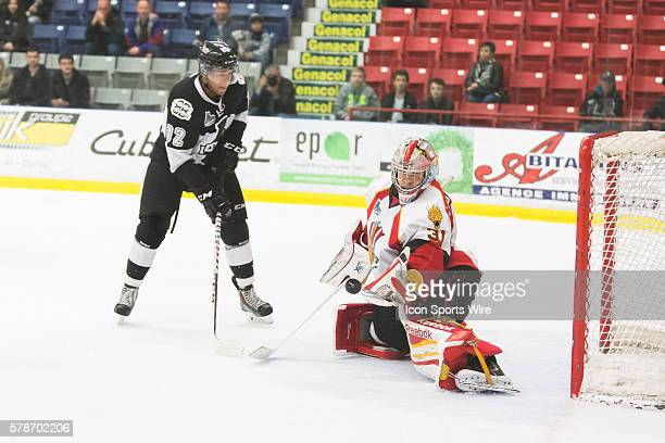 Philippe Cadorette of the BaieComeau Drakkar makes a save while Marcus Hinds of the BlainvilleBoisbriand Armada is watching in game 3 during the...