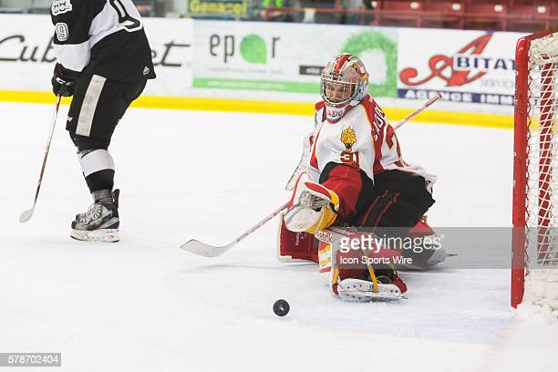Philippe Cadorette of the BaieComeau Drakkar makes a save in game 3 during the third round of the 2014 QMJHL playoffs at the Centre d'excellence...