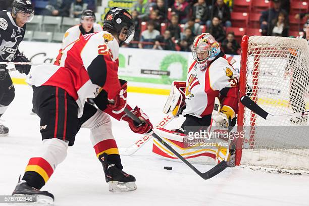 Philippe Cadorette of the BaieComeau Drakkar making a save while Alexandre Chenevert of the BaieComeau Drakkar clears the puck in game 3 during the...
