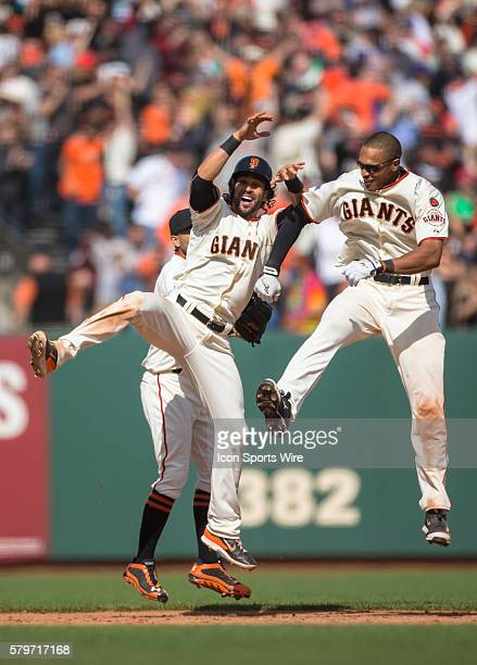 San Francisco Giants center fielder Angel Pagan and San Francisco Giants right fielder Justin Maxwell celebrate their win after a Major League...