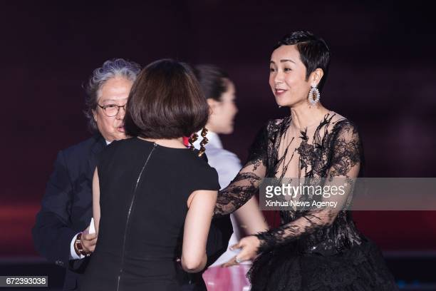 Actress Jiang Wenli presents the trophy of the Tiantan Award for Best Actor to the movie 'Mr No Problem' during the awarding ceremony of the Tiantan...
