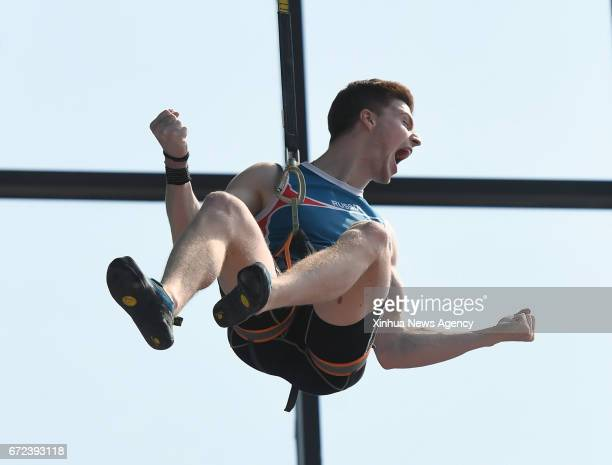 Vladislav Deulin of Russia celebrates after the men speed final at the IFSC Climbing World Cup Chongqing 2017 in Chongqing southwest China April 23...