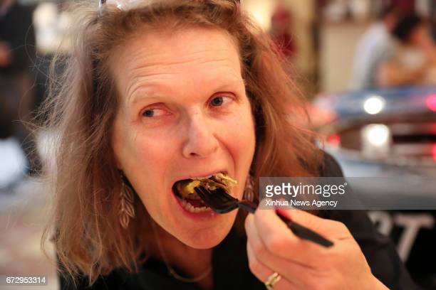 NEW YORK April 25 2017 A customer eats Jianbing of Mr Bing in UrbanSpace food court in New York the United States April 17 2017 UrbanSpace in midtown...