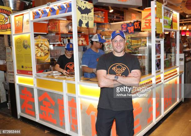 NEW YORK April 25 2017 Brian Goldberg poses in front of the kiosk of Mr Bing in UrbanSpace food court in New York the United States April 17 2017...