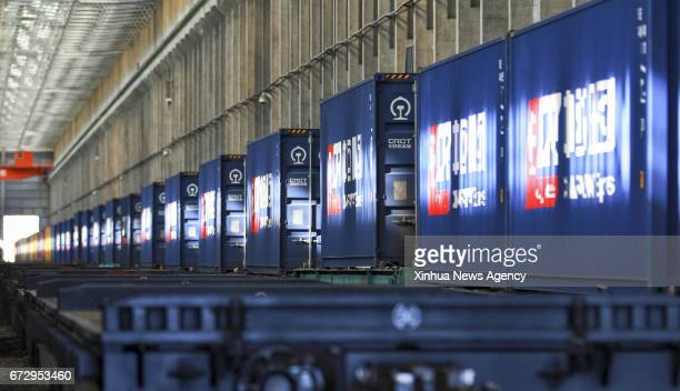PASS April 25 2017 Photo taken on April 24 2017 shows containers full of British products carried by the first LondonYiwu cargo train at the Alataw...