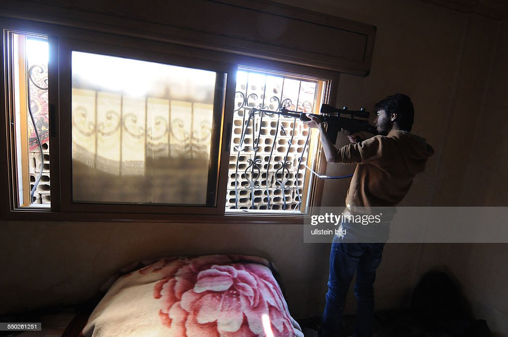 April 25 Yabrud Rif Dimashq Syria An FSA fighter is taking aim at government troops controlling the next town over Al Nabk Situated 80KM North of...
