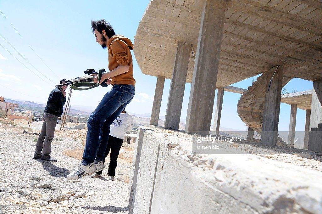 April 25 Yabrud Rif Dimashq Syria An FSA fighter is taking cover after shooting at government troops controlling the next town over Al Nabk Situated...
