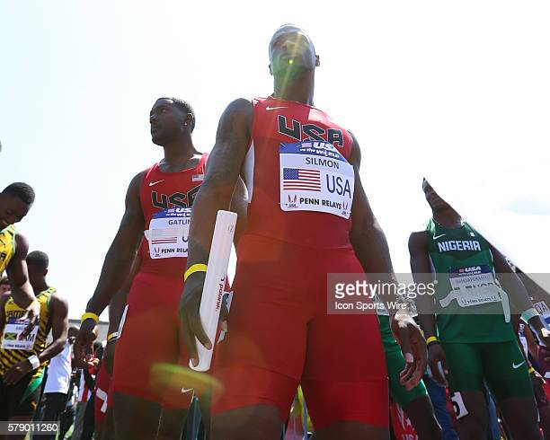 Team USA's Charles Silmon and Justin Gatlin stand in the staging area prior to the USA vs the World Men's 4x100 event at the Penn Relays at Franklin...
