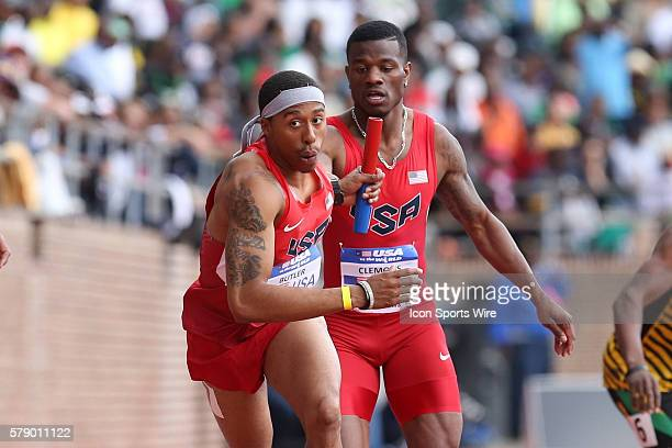 USA's Kyle Clemons hands the baton to Kind Butler during the USA vs the World Men's 4x400 event at the Penn Relays at Franklin Field on the campus of...