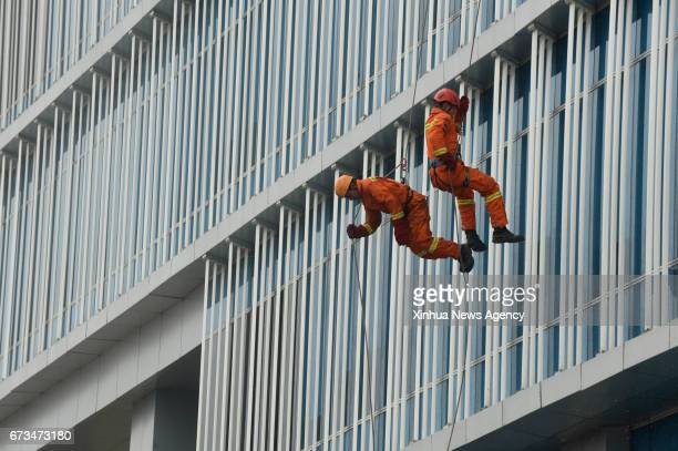 JAKARTA April 26 2017 People participate in a fire drill held by Indonesia's National Disaster Management Authority during National Disaster...