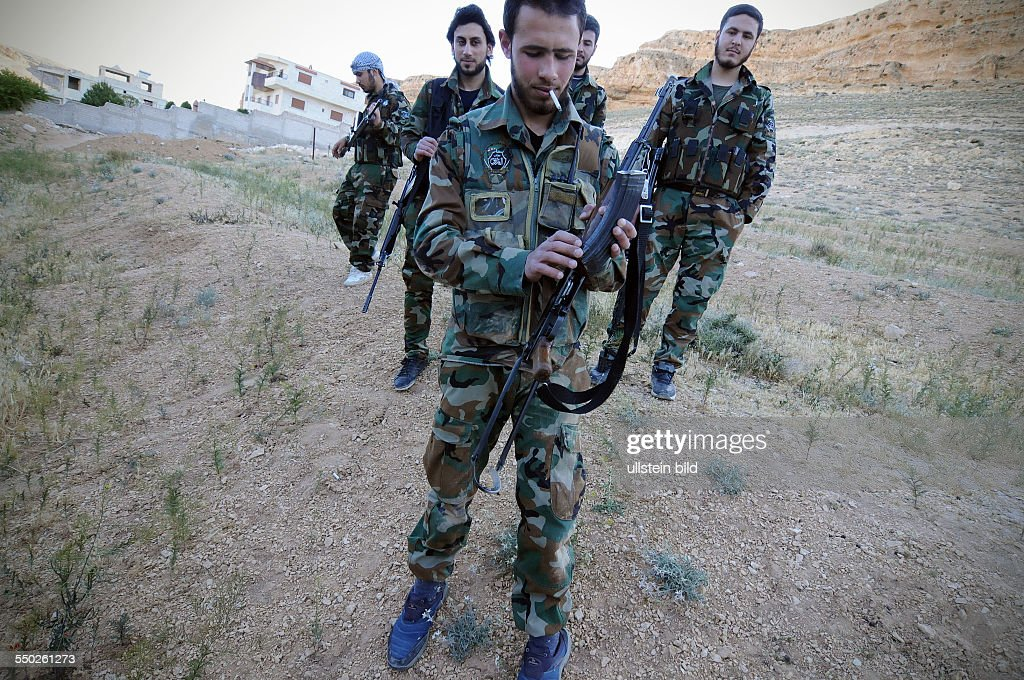 April 27 Yabrud Rif Dimashq Syria A Katiba leader center is taking a break with his men during a patrol on the outskirts of Yabrud shalled daily by...