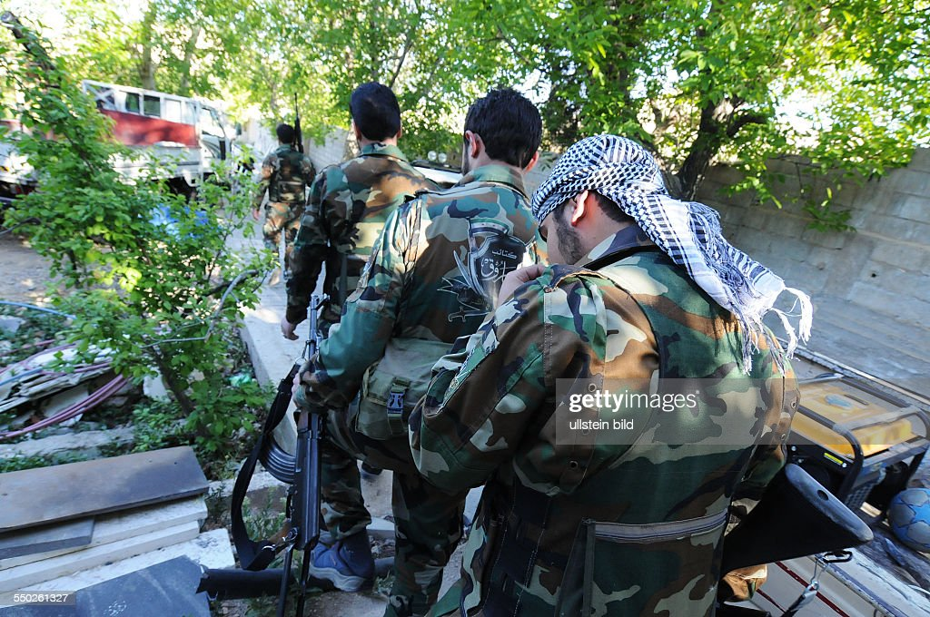 April 27 Yabrud Rif Dimashq Syria Members of the FSA Al Faruk brigade are going on patrol from their hidden location inside the city of Yabrud This...