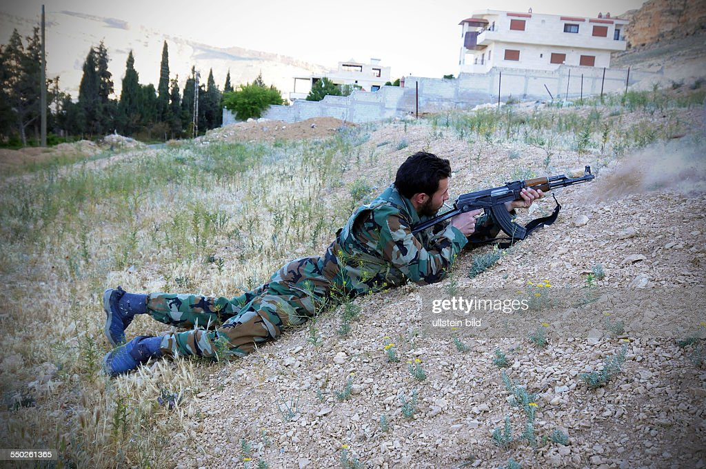 April 27 Yabrud Rif Dimashq Syria The leader of a Katiba is firing his weapon on the outskirts of Yabrud This regiment is the most famous brigade in...