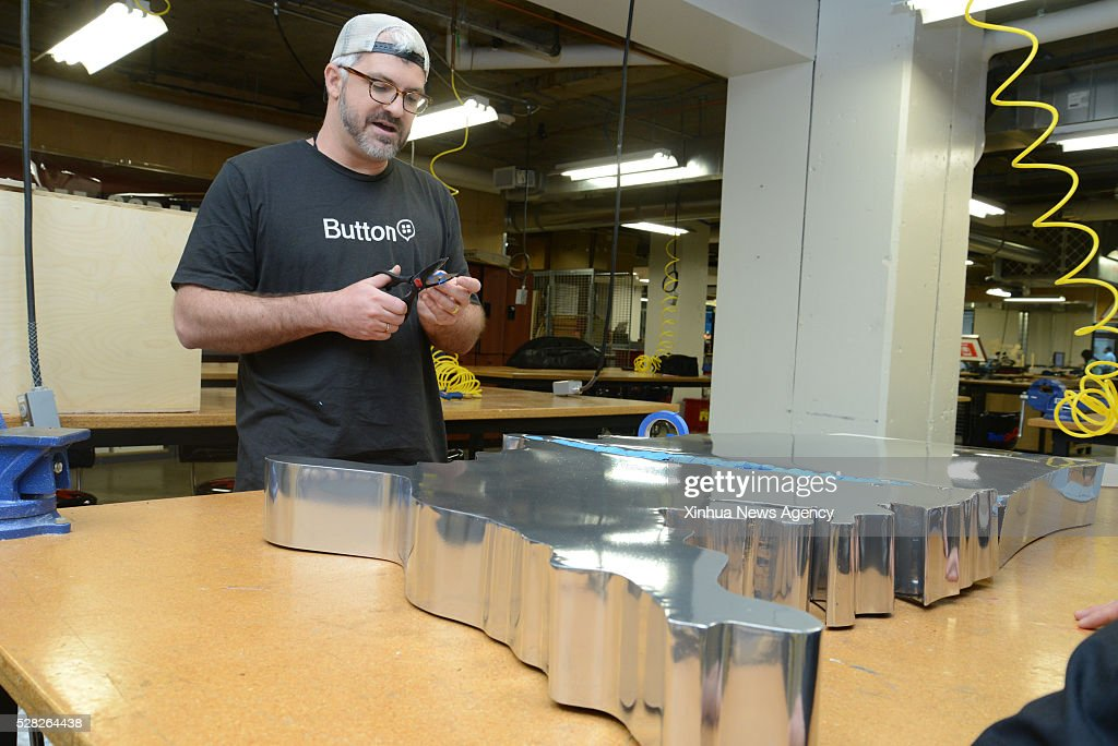 ARLINGTON, VA, April, 28 2016-- A man makes an iron map in TechShop in Arlington, Virginia, the United States, April 28, 2016. California-based tech company TechShop opened its office in Arlington two years ago. It trains entrepreneurs to make their products using current cutting-edge equipment and computer design software. Talking about cutting-edge startups people usually think about Silicon Valley, while Arlington, a county in North Virginia within the Washington metropolitan area has also become a hot spot for tech startups.