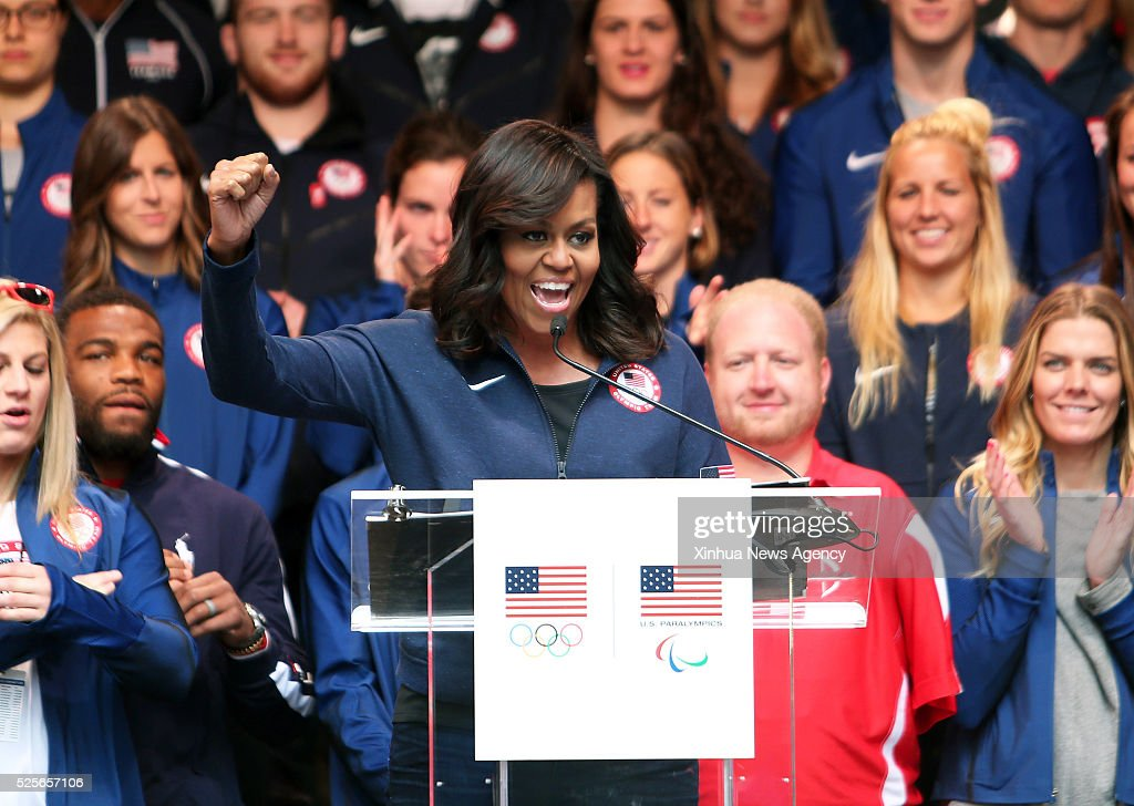 NEW YORK, April 28, 2016-- U.S. First Lady Michelle Obama delivers a speech during the Team USA's 'Road to Rio Tour' activity at Times Square in New York, the United States on April 27, 2016. Team USA's 'Road to Rio Tour' was held at Times Square on Wednesday to mark the 100-Day countdown to the 2016 Olympic Games in Rio de Janeiro. More than 70 Olympic and Paralympic athletes participated in the event and shared their spirit and excitement of the Games with fans here.