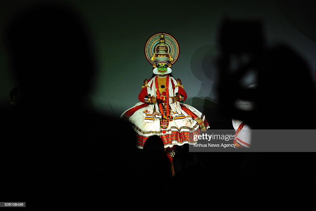 SINGAPORE, April 29, 2016 -- Visitors watch traditional Indian Kathakali performance on the front lawn of the National Museum of Singapore on Apr 29, 2016. Today, the Singapore HeritageFest 2016 was launch in the National Museum of Singapore. The SHF 2016 will be held from April 29 to May 15 in Singapore.