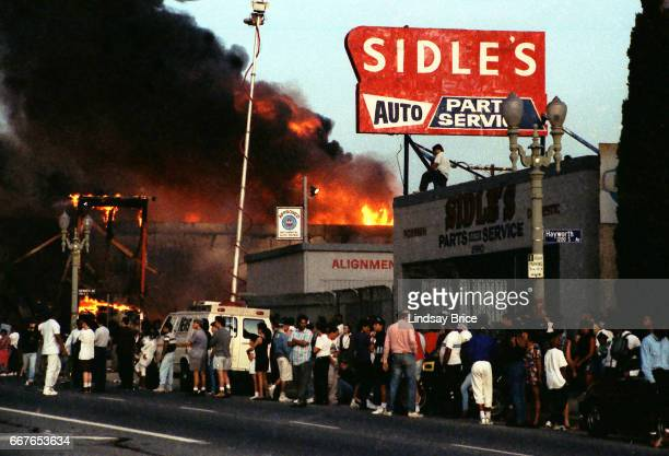 LOS ANGELES April 30 Rodney King Riot Local residents gathering and helplessly watching businesses burning at intersection of Pico Boulevard and...