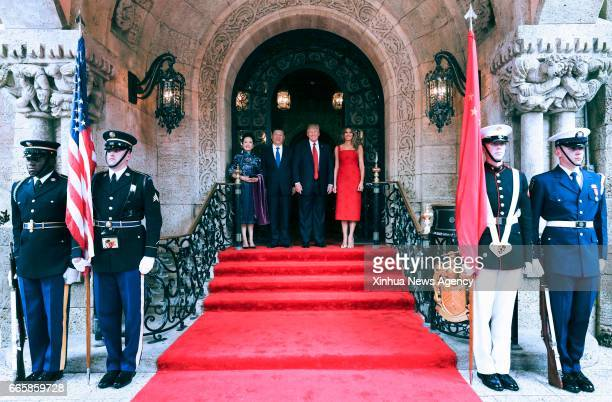 BEACH April 6 2017 Chinese President Xi Jinping and his wife Peng Liyuan pose for a photo with US President Donald Trump and First Lady Melania Trump...