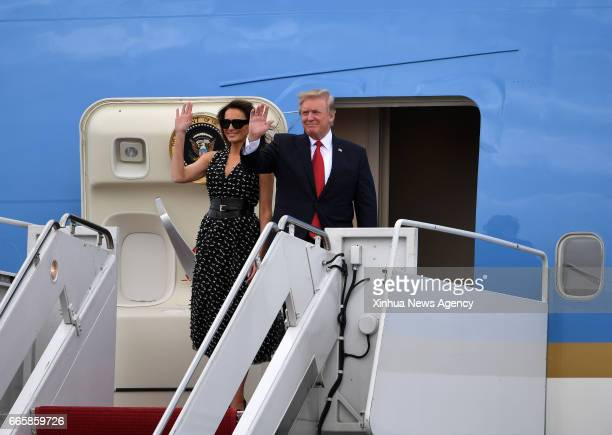 BEACH April 6 2017 US President Donald Trump and First Lady Melania Trump arrive together on Air Force One at the Palm Beach International Airport...