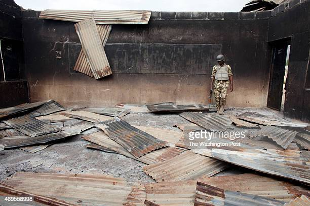 A soldier walks through a destroyed classroom at the UBE Junior Secondary School in Gwoza Nigeria the former base of Boko Haram recently retaken by...