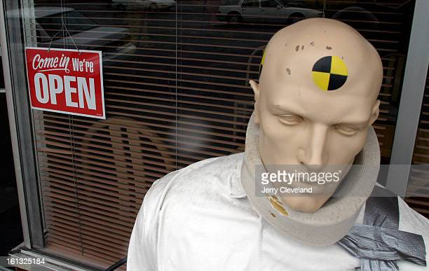 DENVER COLO April 9 2004 A crash test dummy with a neck brace sits outside a chiropractor's office on Krameria St between 14th St and E Colfax Ave...