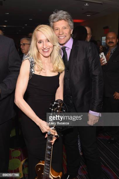 April Anderson and Jon Bon Jovi pose backstage at the Songwriters Hall Of Fame 48th Annual Induction and Awards at New York Marriott Marquis Hotel on...