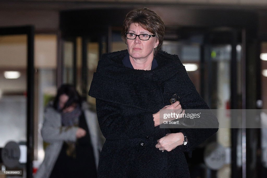 April Casburn, the former head of Scotland Yard's National Terrorist Financial Investigation Unit, leaves Southwark Crown Court after the first day of standing trail accused of misconduct in a public office and breaching the Official Secrets Act on January 7, 2013 in London, England. Ms Casburn has pleaded not guilty to charges that she offered information to the now defunct News of the World newspaper concerning Scotland Yard's investigation into whether the inquiry in to the practices of phone hacking should be reopened.