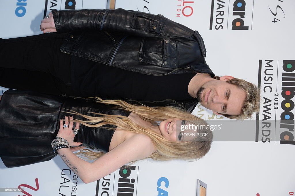 April Lavigne and Chad Kroeger arrive on the red carpet at the 2013 Billboard Music Awards at the MGM Grand in Las Vegas, Nevada, May 19, 2013.