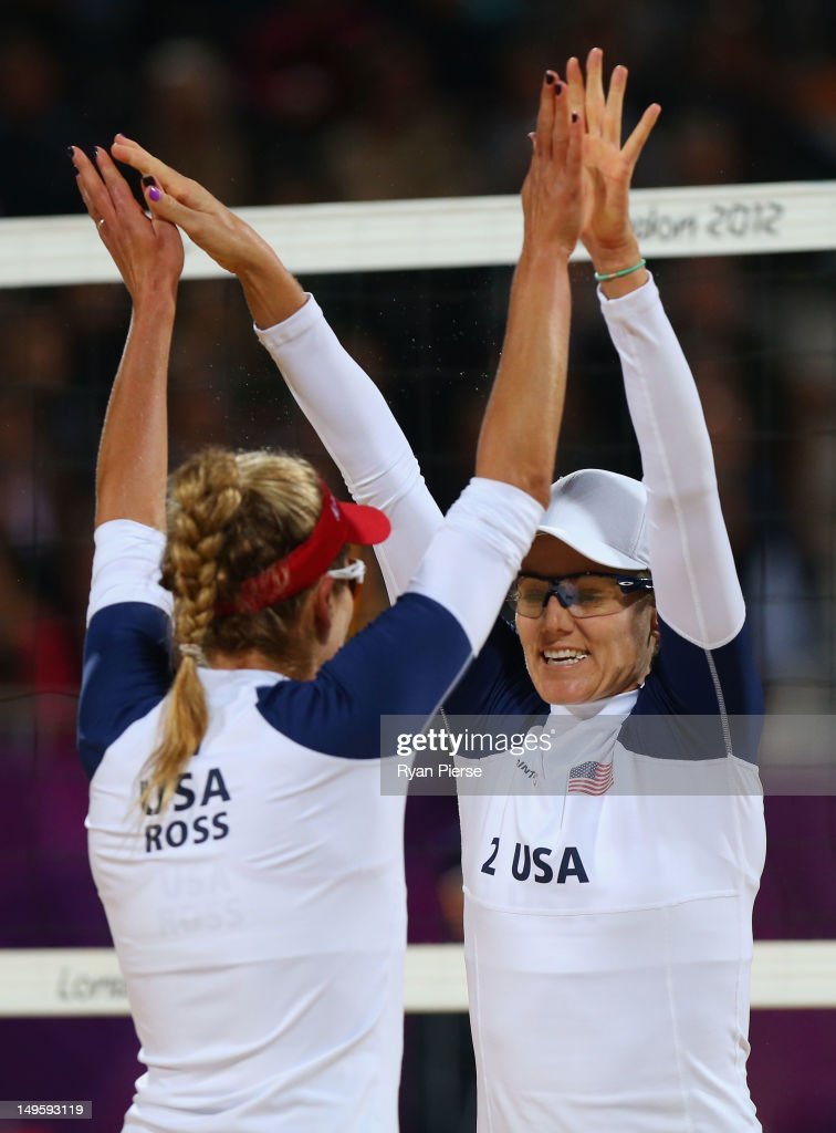 April Ross and Jennifer Kessy of United States celebrate a point during the Women's Beach Volleyball Preliminary match between United States and the Netherlands on Day 4 at Horse Guards Parade on July 31, 2012 in London, England.