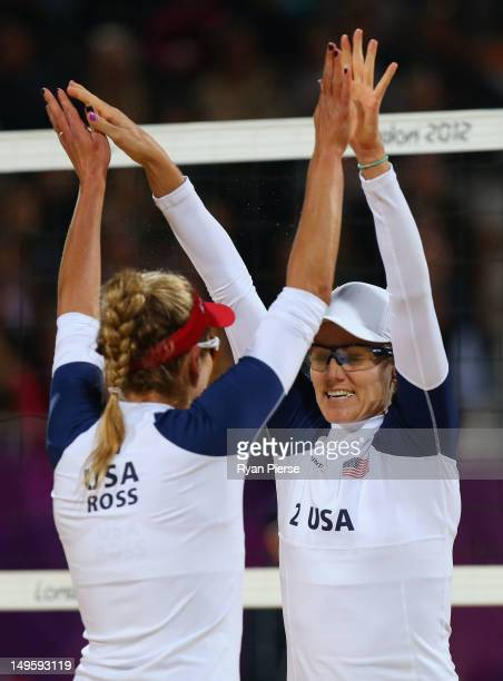 April Ross and Jennifer Kessy of United States celebrate a point during the Women's Beach Volleyball Preliminary match between United States and the...