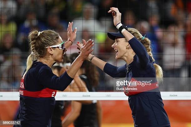 April Ross and Kerri Walsh Jennings of the United States celebrate a point during the Women's Round of 16 match against Marta Menegatti and Laura...