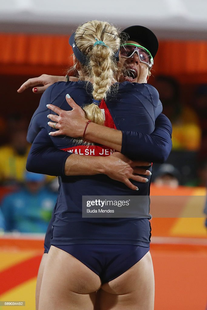 April Ross and Kerri Walsh Jennings of the United States celebrate victory in the Women's Round of 16 match against Marta Menegatti and Laura Giombini of Italy on Day 7 of the Rio 2016 Olympic Games at the Beach Volleyball Arena on August 12, 2016 in Rio de Janeiro, Brazil.