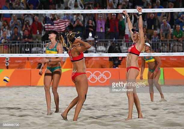 April Ross and Kerri Walsh Jennings of the United States victory after the Women's Beach Volleyball preliminary round Pool C match against Mariafe...
