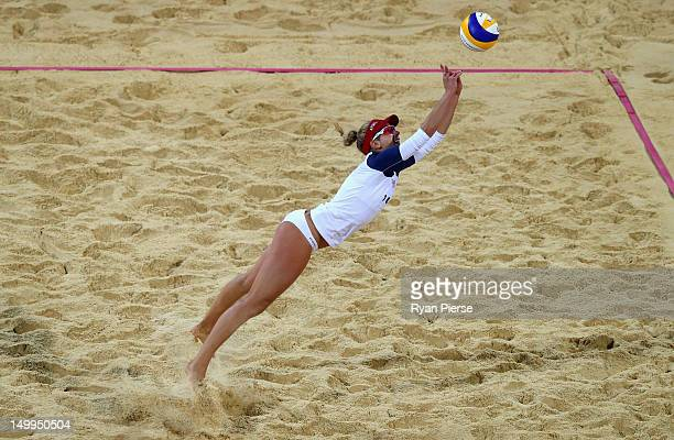 April Ross of the United States dives for the ball during the Women's Beach Volleyball Semi Final match between United States and Brazil on Day 11 of...