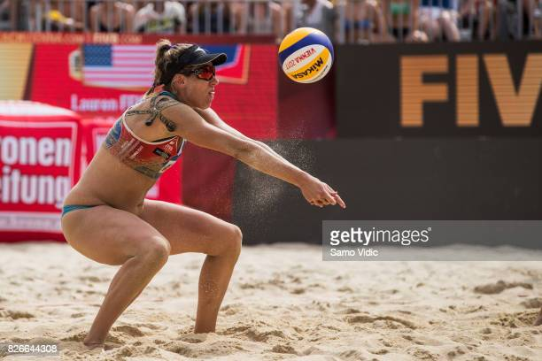 April Ross of the United States receives the ball during the gold medal match against Laura Ludwig and Kira Walkenhorst of Germany at FIVB Beach...