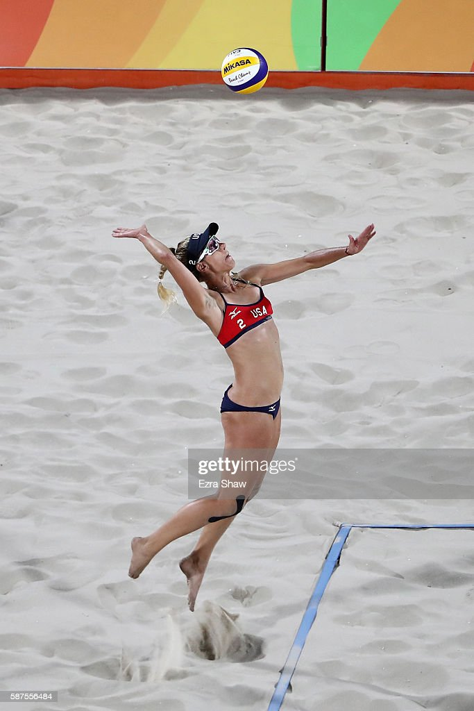 April Ross of United States serves the ball during the Women's Beach Volleyball preliminary round Pool C match against Fan Wang and Yuan Yue of China...