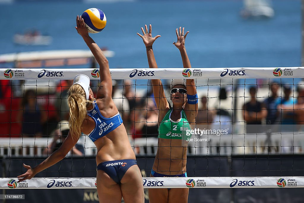 <a gi-track='captionPersonalityLinkClicked' href=/galleries/search?phrase=April+Ross&family=editorial&specificpeople=4296381 ng-click='$event.stopPropagation()'>April Ross</a> of USA (L) spikes the ball over <a gi-track='captionPersonalityLinkClicked' href=/galleries/search?phrase=Talita+Antunes&family=editorial&specificpeople=5083240 ng-click='$event.stopPropagation()'>Talita Antunes</a> of Brazil during a women's final match at the ASICS World Series Cup - Day 2 on July 28, 2013 in Long Beach, California.