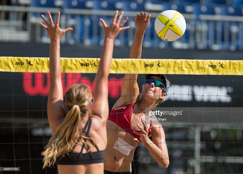 April Ross spikes the ball against Betsi Flint at the AVP Salt Lake City Open on August 8 2014 at Liberty Park in Salt Lake City Utah