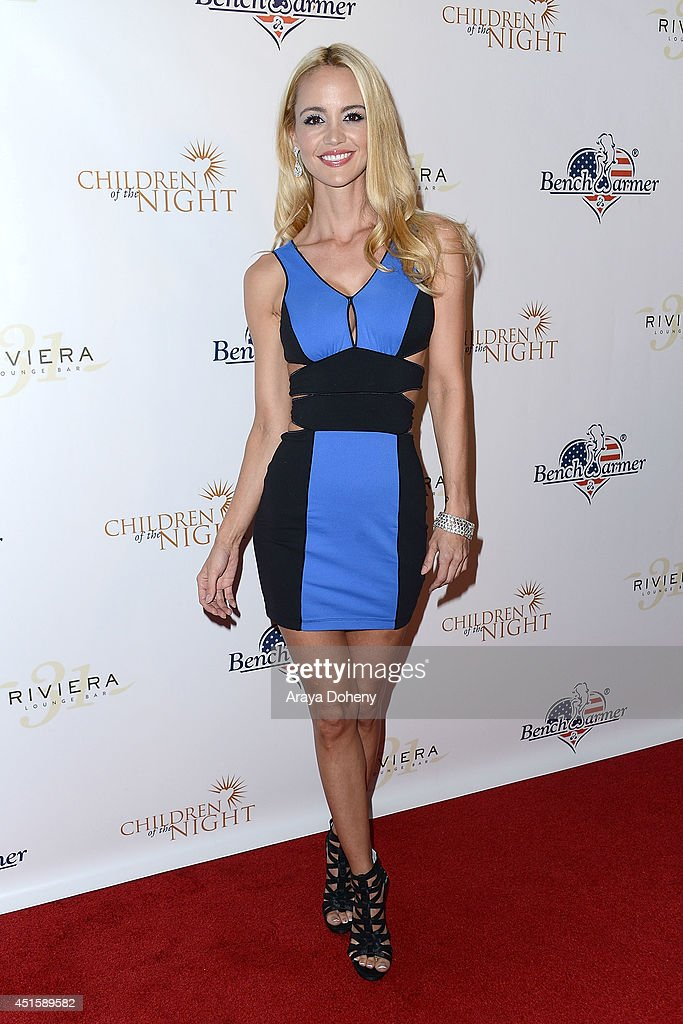 April Scott attends the Children of The Night and BenchWarmer's annual Stars & Stripes event on July 1, 2014 in Los Angeles, California.