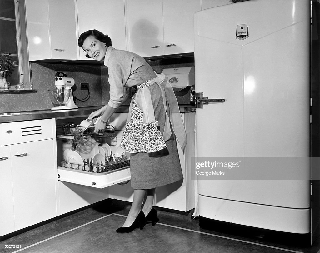 Apron housewife at kitchen dish washer : Stock Photo