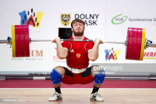 Apti Aukhadov from Russia lifts in the Clean Jerk competition men's 85 kg Group A during weightlifting IWF World Championships Wroclaw 2013 at...