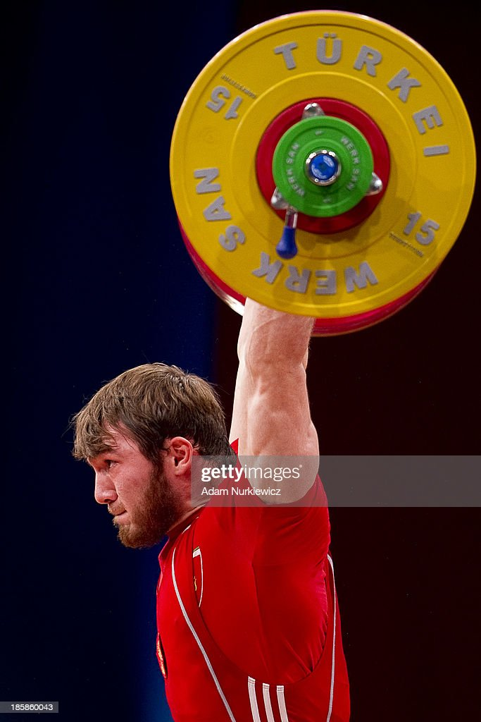 Apti Aukhadov from Russia lifts in the Clean & Jerk competition men's 85 kg Group A during weightlifting IWF World Championships Wroclaw 2013 at Centennial Hall in Wroclaw on October 25, 2013