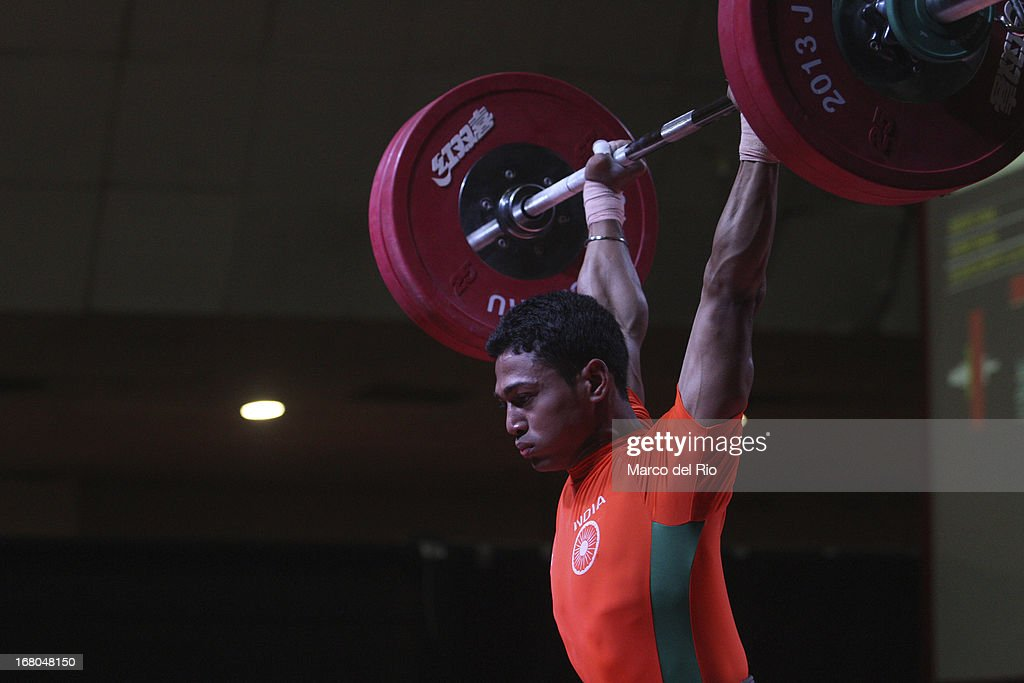 Apurba Chatia of India A competes in the Men's 56kg during day one of the 2013 Junior Weightlifting World Championship at Maria Angola Convention Center on April 04, 2013 in Lima, Peru.