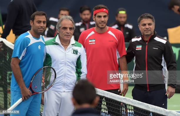 Aqeel Khan and team coach Rashid Ahmad Malik of Pakistan and Anoosha Shahgholi and team captain Saeed Ahmadvand of Iran pose for a photograph ahead...