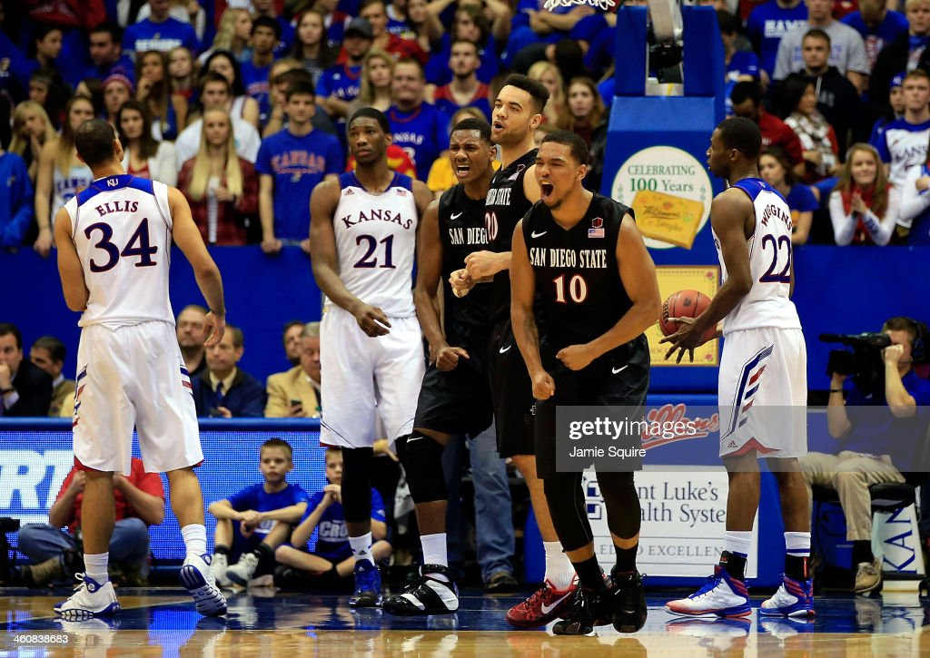 Aqeel Quinn JJ O'Brien and Skylar Spencer of the San Diego State Aztecs celebrate as the Aztecs defeat the Kansas Jayhawks 6157 to win the game at...