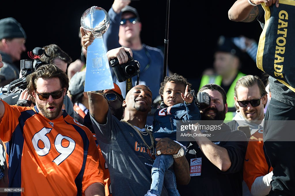 Aqib Talib hoists the Lombardi Trophy during the Denver Broncos Super Bowl championship celebration and parade on Tuesday February 9, 2016.